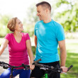 Stock Photo: Couple on bikes outdoors