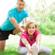 Couple Exercising In Park — Stock Photo #27252485
