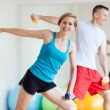Stock Photo: Couple working out with dumbbells