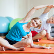 Couple doing yoga — Stock Photo