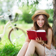 Woman reading a book under the tree — Stock Photo #27259213
