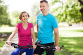 Couple on bikes outdoors — Stock Photo