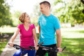 Couple on bikes outdoors — Stock Photo
