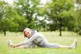 Woman stretching in a park — Stock Photo