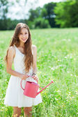 Woman watering flowers — Stock Photo