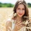 Stock Photo: Beautiful woman in the wheat field
