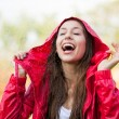 Woman in raincoat enjoying the rain — Stock Photo #27261797