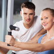 Woman exercising with personal trainer — Stock Photo #27265995