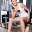 Foto de Stock  : WomLifting Dumbbells