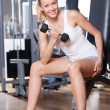 图库照片: WomLifting Dumbbells