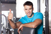 Young man working out at the gym — Stock Photo