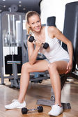 Woman Lifting Dumbbells — 图库照片