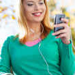 Young woman with music player — Stock Photo