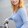 Woman outdoors on bicycle — Stock Photo