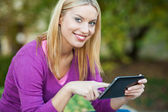 Young woman using digital tablet — Stock Photo