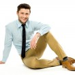 Young businessman sitting — Stock Photo