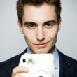 Man with instant camera — Stock Photo #27345329