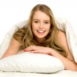 Young woman lying on bed — Stock Photo #27378667