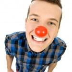 genç adam giyen kırmızı burun — Stok fotoğraf