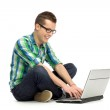 Young guy using laptop — Stock Photo