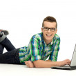 Young man using laptop — Stock Photo #27379853
