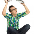 Young man holding laptop above head — Stock Photo #27379987