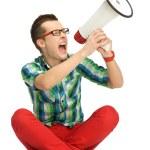 Young man shouting through megaphone — Stock Photo