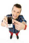 Casual young man with phone — Stockfoto