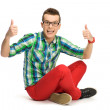 Young man showing thumbs up — Stock Photo