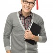Graduate holding book — Stock Photo #27380231