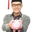 Student holding piggy bank — Stock Photo