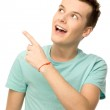 Young man pointing up — Stock Photo #27380279