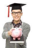 Student holding piggy bank — Stock Photo