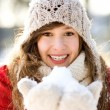 Woman holding a snowball — Foto Stock
