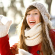 Girl throwing a snowball — Stok fotoğraf