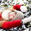 Young Woman Lying in the Snow — Stock Photo
