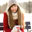 Stock Photo: Winter womwith hot coffee