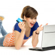 Woman holding credit card using laptop — Stock Photo #27516343