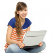 Young woman using laptop — Stock fotografie