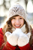 Woman holding a snowball — Stock Photo