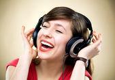 Young woman wearing headphones — Stock Photo