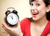 Young woman holding alarm clock — Stock Photo