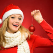 Woman in Santa hat with Christmas present — Stock Photo