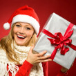 Stockfoto: Woman in Santa hat with Christmas present