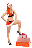 Woman in Santa costume holding gifts — Stock Photo