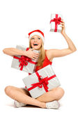 Woman in Santa hat holding gifts — Stock Photo