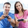 Couple playing video games — Stock Photo #27659647