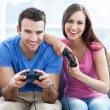 Couple playing video games — Stock Photo #27659659