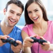 Couple playing video games — Stock Photo #27659663