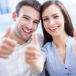 Young couple with thumbs up — Stock Photo